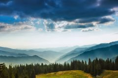 Majestic landscape of summer mountains. A view of the misty slopes of the mountains in the distance. Stock Image