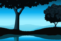 Majestic landscape with tree. And lake in blue color Stock Image
