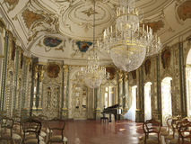 Majestic large decorated piano concert hall. With golden decorations, sculptures, frescos and chandeliers Stock Photo