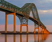 Laviolette Bridge Across The St. Lawrence River. The majestic Laviolette Bridge lit by the late day sun. The bridge spans the St. Lawrence River at the city of royalty free stock photography