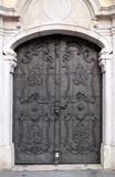 Majestic medieval door with ornate metal pattern and stone columns in Salzburg. Austria Stock Photography