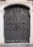 Majestic medieval door with ornate metal pattern and stone columns in Salzburg. Austria Royalty Free Stock Photos