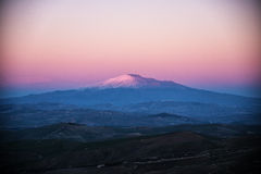 The majestic Mount Etna. In the beautiful scenery at sunset royalty free stock images