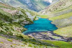 Majestic mountain lake in Kyrgyzstan Stock Photos