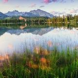 Majestic mountain lake in National Park High Tatra. Strbske ples Stock Photos