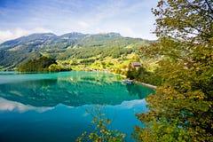 Majestic mountain lake in Switzerland. Majestic emerald mountain lake in Switzerland Royalty Free Stock Image