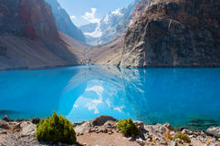 Majestic mountain lake in Tajikistan. Majestic blue mountain lake in Tajikistan. Fann Mountains Stock Image