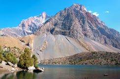 Majestic mountain lake in Tajikistan. Majestic blue mountain lake in Tajikistan. Fann Mountains Royalty Free Stock Photos