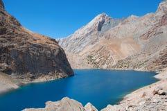 Majestic mountain lake in Tajikistan. Majestic blue mountain lake in Tajikistan. Fann Mountains Royalty Free Stock Images