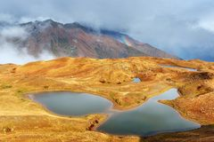 Majestic mountain landscape. Koruldi lakes and a tourist admiring the view. Active life concept Stock Photography