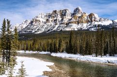 Majestic Mountain Landscape in Winter. Majestic Castle Mountain with Bow River in Foreground on a Winter Day. Banff National Park, Alberta, Canada Royalty Free Stock Photos