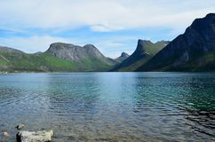 Majestic mountain peaks and blue fjord landscape senja island. Summertime Stock Image