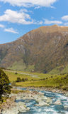 Majestic mountain and stream landscape Stock Photography