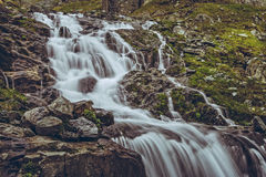 Majestic mountain stream waterfall Royalty Free Stock Image