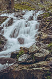 Majestic mountain stream waterfall Stock Images