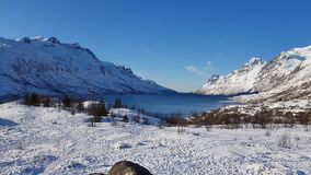 Majestic mountain valley peak with clean white snow and blue sky view, arctic circle, northern norway stock video footage