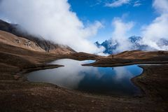 Majestic mountain view with the lake. Majestic mountain landscape. Koruldi lakes and a tourist admiring the view. Active life concept stock image