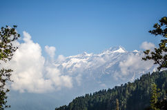 The majestic mountain. A view of a snow capped peak near manali, himahcal pradesh as seen from trail to Bhrigu lake Stock Photo