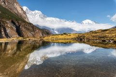 Majestic mountains with beautiful reflection in water Stock Photography