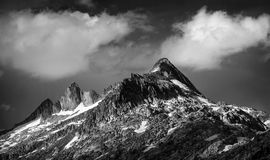 Majestic mountains landscape. Black and white photo of majestic mountainous landscape, dramatic cloudy sky, beautiful panorama, extreme adventure and travelling Stock Photo