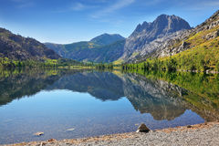 The majestic mountains are reflected in the water Royalty Free Stock Photo
