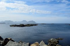 Majestic ocean landscape with many small rocky islands and mountain backdrop. In the arctic circle royalty free stock photos