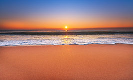 Majestic ocean sunset. Majestic ocean sunset with a breaking wave Royalty Free Stock Photo