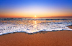Majestic ocean sunset. Majestic ocean sunset with a breaking wave royalty free stock photography