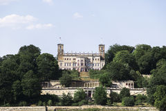 Majestic old German castle on the hill in summer forest. Royalty Free Stock Images