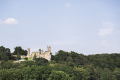 Majestic old German castle on the hill in summer forest. Royalty Free Stock Image