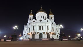 Majestic orthodox Cathedral of Christ Saviour. Illuminated at dusk on bank of Moscow river. It is tallest Orthodox church in world. Timelapse hyperlapse, Russia stock video