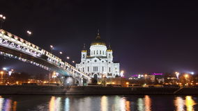 Majestic orthodox Cathedral of Christ Saviour. Illuminated at dusk on bank of Moscow river. It is tallest Orthodox church in world. Timelapse hyperlapse, Russia stock footage