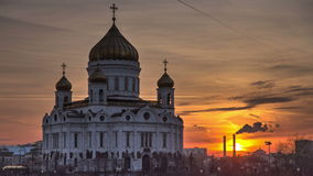 Majestic orthodox Cathedral of Christ Saviour with. Sunset on bank of Moscow river. It is tallest Orthodox church in world. Timelapse, Russia 4K stock video footage