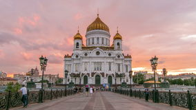 Majestic orthodox Cathedral of Christ Saviour with. Sunset on bank of Moscow river. It is tallest Orthodox church in world. Timelapse from the Patriarchal stock video
