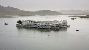 Majestic palace on lake island stock footage