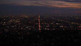 Majestic Panorama of Downtown Los Angeles At Sunset. A beautiful blurry panorama of Los Angeles, California at the very beginning of sunrise or sunset. Night stock video footage