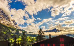 Majestic Panoramic view of Grindelwald Landscape and Cloudscape with golden light reflected, Canton of Berne, Switzerland royalty free stock photography
