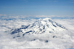 Majestic peak. The majestic peak of Mt Rainier towering above the clouds Royalty Free Stock Image