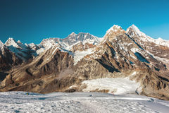 Majestic Peaks of Central Himalaya view. View of Central Himalaya Peaks Glacier with deep eternal Snow and majestic Peaks on Background royalty free stock images