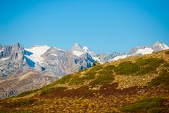 The majestic peaks of the Massif des Ecrins 4101 m national park with the glaciers, in France. Telephoto view from distant at hi Stock Photo