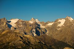 The majestic peaks of the Massif des Ecrins 4101 m national park with the glaciers, in France. Telephoto view from distant at su Royalty Free Stock Photography