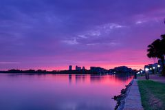 Majestic pink and purple sunset reflecting in a bay of water. Waterfront properties royalty free stock images