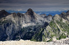 The majestic Razor peak, Julian Alps and layer of clouds Royalty Free Stock Image