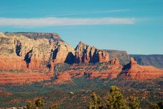 The majestic red rocks of the Arizona mountains near Sedona. The picture shows the multi-colored, layered rocks of the mountains near Sedona, Arizona.  The Royalty Free Stock Image