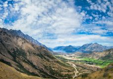 Majestic Remarkables Mountains in summer in New Zealand. Panoramic View from above on the winding road from Queenstown to The Remarkables Ski Area showing Stock Images