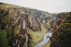 Majestic rocky mountains with green vegetation and small river. In fjadrargljufur, iceland stock photos