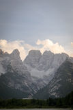 Majestic rocky mountains. Vertical view of majestic rocky mountains. Picture of valley in Italian Dolomites. UNESCO World Heritage Site Stock Photos