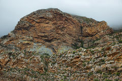 Majestic rocky redish mountains in Seweweekspoort pass Stock Photos