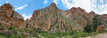 Majestic rocky redish mountains in Swartberg pass. South Africa Royalty Free Stock Photo