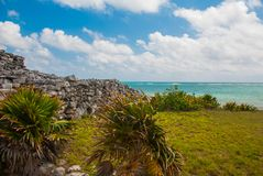 Majestic ruins in Tulum.Tulum is a resort town on Mexicos Caribbean coast. The 13th-century, walled Mayan archaeological site at T stock image